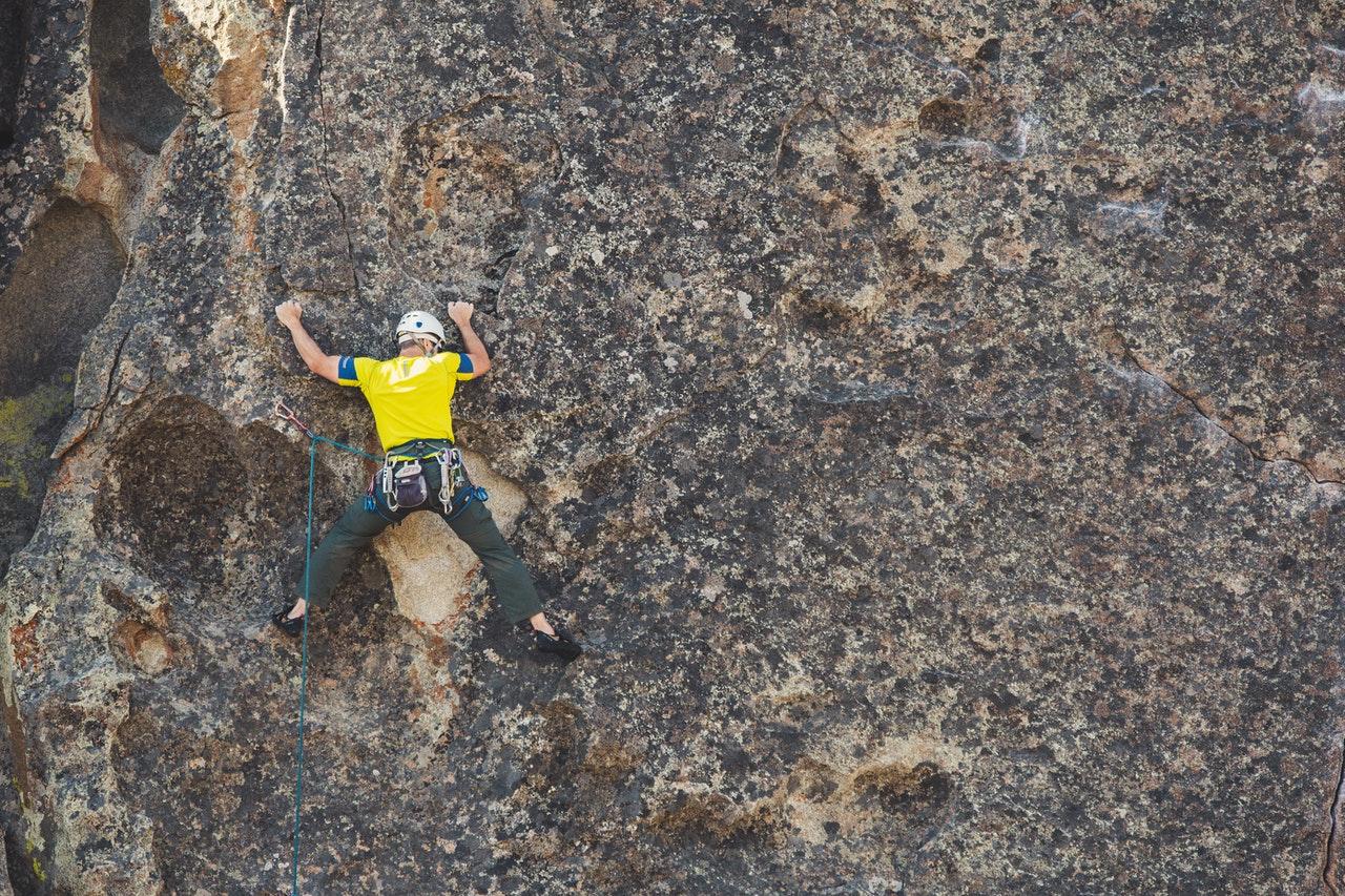 man doing outdoor rock climbing 1574216